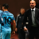 Rage: Pep Guardiola has a go at Sergio Aguero and David Silva