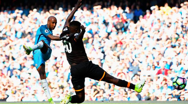Pinpoint accuracy: Fabian Delph blasts Manchester City 3-0 up with a long-range drive despite the close attention of Hull's Adama Diomandé