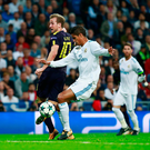Muddle: Raphael Varane deflects Harry Kane's flick into his own net to put Spurs in front