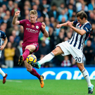 Eyes on the prize: Kevin de Bruyne battles with West Brom's Grzegorz Krychowiak