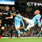 Karate kid: David Silva scores his 83rd-minute winner against West Ham in dramatic style at the Etihad