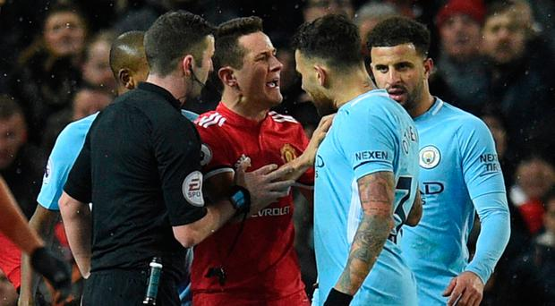 No joy: Ander Herrera is booked for 'diving' by referee Michael Oliver