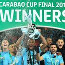 Champions: Vincent Kompany lifts the cup for Manchester City