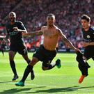 Record-breaker: Gabriel Jesus celebrates after scoring City's last gasp winner