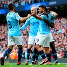 In control: Sergio Aguero celebrates putting City 3-0 up