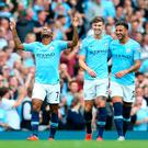 Top form: Raheem Sterling of Manchester City celebrates after scoring his team's first goal with Kyle Walker and John Stones