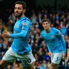 Goals galore: Bernardo Silva celebrates firing City 2-0 up, they eventually won 5-0