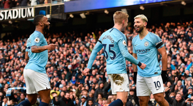 Grinning feeling: Sergio Aguero is all smiles after putting Man City 3-0 up