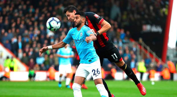 Back up: City's Riyad Mahrez is challenged by Charlie Daniels