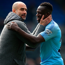 Winning ways: Pep Guardiola celebrates with Benjamin Mendy