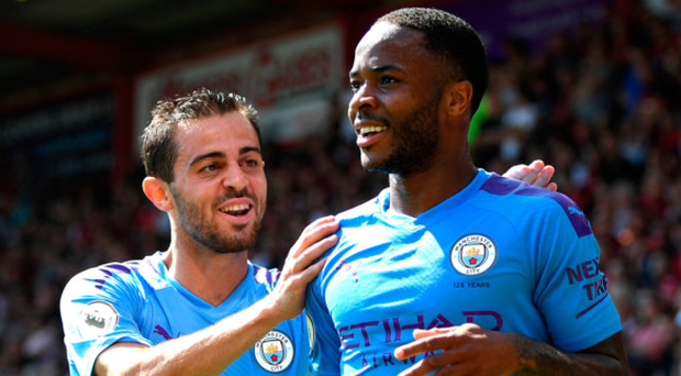 Second helpings: Raheem Sterling celebrates scoring City's second goal with Bernardo Silva