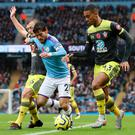 Forward motion: David Silva takes on Southampton pair James Ward-Prowse and Yan Valery