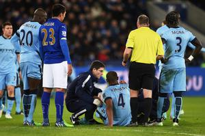 Down and out: Vincent Kompany suffered an injury on Saturday
