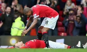 Flat out: Ashley Young pretends to help his skipper