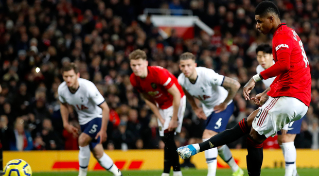 At the double: Marcus Rashford slots home a penalty