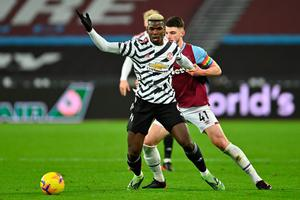 Holding on: Paul Pogba tries to break free from the grip of Declan Rice during Manchester United's 3-1 victory over West Ham United