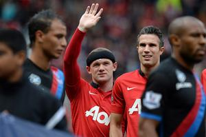 Manchester United's Wayne Rooney greets home fans before the Barclays Premier League match at Old Trafford, Manchester, Saturday September 14, 2013