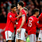 Great start: Harry Maguire congratulates Marcus Rashford on breaking the deadlock against Norwich