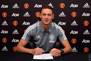 Sign here: Nemanja Matic puts pen to paper after agreeing a three-year deal with Manchester United