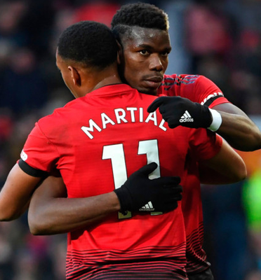 Off and running: Paul Pogba celebrates with Anthony Martial after opening the scoring