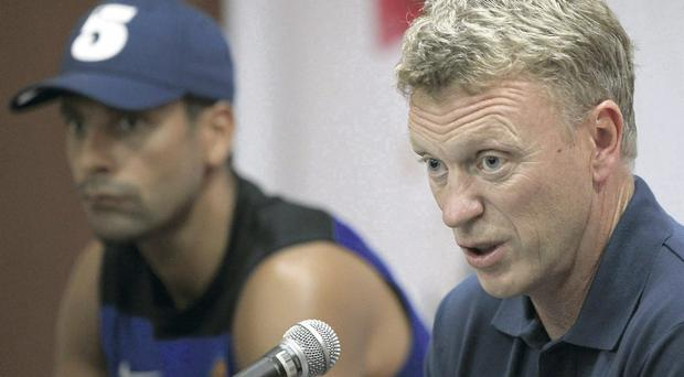Talks ongoing: David Moyes and Rio Ferdinand address the media in Thailand yesterday