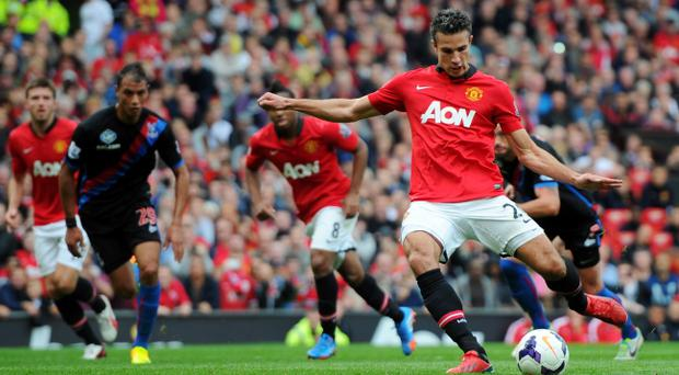 MANCHESTER, ENGLAND - SEPTEMBER 14: Robin van Persie of Manchester United scores from the penalty spot during the Barclays Premier League match between Manchester United and Crystal Palace at Old Trafford on September 14, 2013 in Manchester, England. (Photo by Michael Regan/Getty Images)