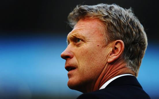 MANCHESTER, ENGLAND - SEPTEMBER 22: David Moyes manager of Manchester United looks on prior to the Barclays Premier League match between Manchester City and Manchester United at the Etihad Stadium on September 22, 2013 in Manchester, England. (Photo by Laurence Griffiths/Getty Images)