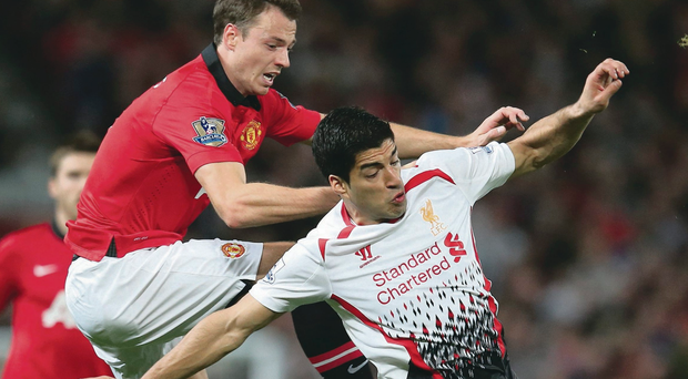 Chest right: Jonny Evans challenges Luis Suarez during Manchester United's 1-0 victory over Liverpool at Old Trafford on Wednesday night