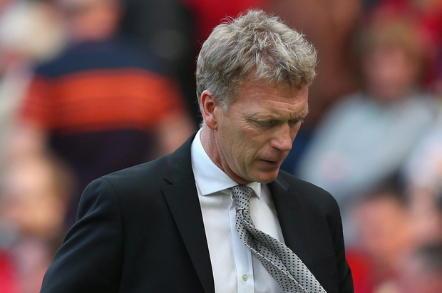 A disappointed David Moyes leaves the pitch after watching his Manchester United team crash to defeat against West Bromwich Albion at Old Trafford on September 28, 2013