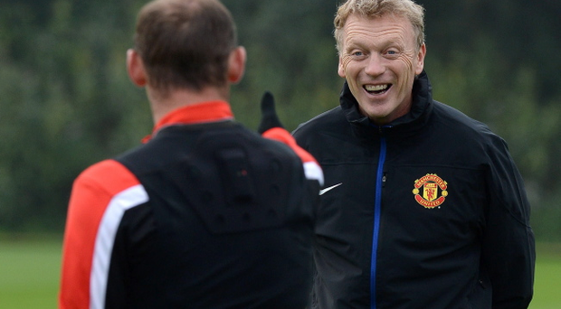 Manchester United manager David Moyes with Wayne Rooney (left) during a training session at the AON Training Complex, Manchester, Tuesday October 1, 2013