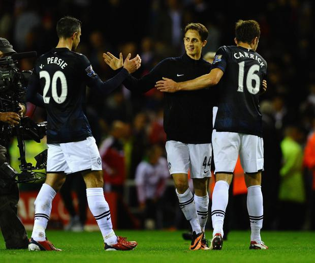 SUNDERLAND, ENGLAND - OCTOBER 05: Adnan Januzaj of Manchester United is congratulated on his goals by Robin Van Persie and Michael Carrick after victory in the Barclays Premier League match between Sunderland and Manchester United at Stadium of Light on October 5, 2013 in Sunderland, England. (Photo by Laurence Griffiths/Getty Images)