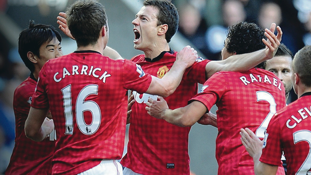 In favour: Jonny Evans (centre) is back playing well and part of the Man United first team