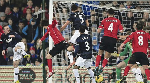 Late joy: Kim Bo-Kyung finds the net in added on time to deny David Moyes a win at the Cardiff City Stadium