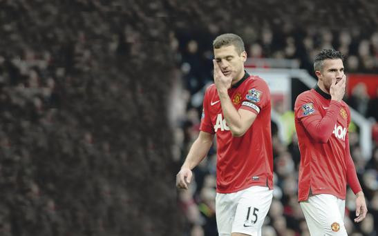 Nightmare continues: Man United's Nemanja Vidic (left) and Robin van Persie show their disappointment during Saturday's defeat to Newcastle United