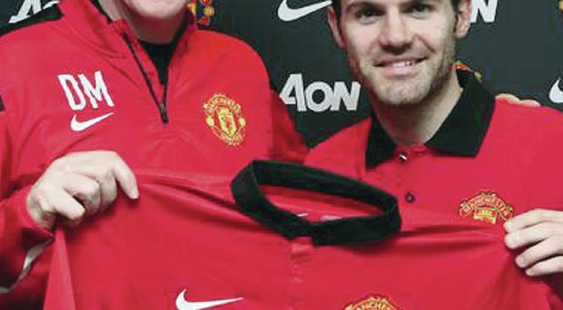 Checking in: David Moyes shows off Manchester United's new £37.1m signing, Juan Mata