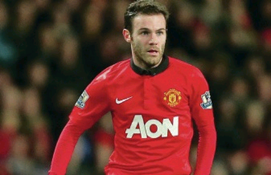 Manchester United's Juan Mata in action against Cardiff