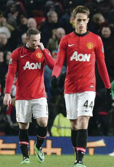 Disgusted: Wayne Rooney, Adnan Januzaj and Michael Carrick cannot believe the Red Devils have flopped again