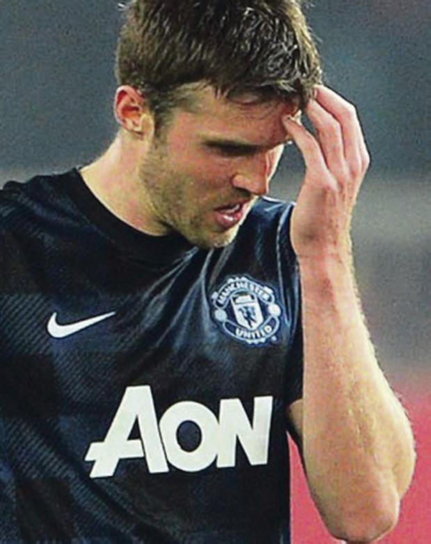 Off night: Michael Carrick is shocked by his side's loss