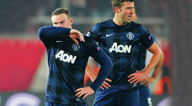 Point of no return: Wayne Rooney and Michael Carrick can't believe it as Manchester United crash to defeat in Greece