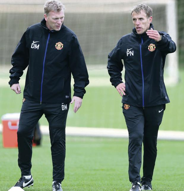 Season of hurt: Coach Phil Neville with David Moyes