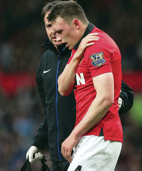 Crocked again: Phil Jones walks off during the game against Hull City, having damaged his shoulder