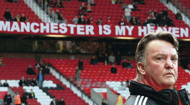 Sign says it all: Louis van Gaal on a previous visit to Old Trafford
