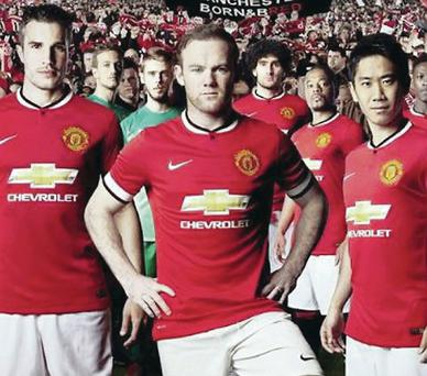 Looking good: Robin van Persie, Wayne Rooney and Shinji Kagawa model the new Manchester United strip