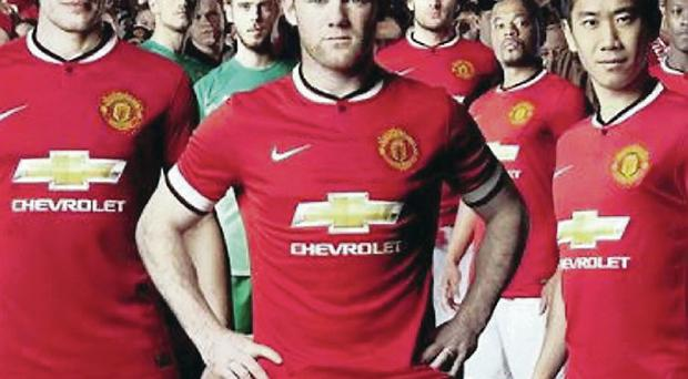 Robin van Persie, Wayne Rooney and Shinji Kagawa model the new Manchester United strip