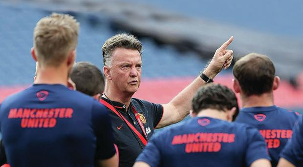 Listen to me: Van Gaal addresses the United first team squad in the US