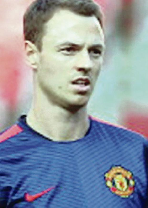 Leader: Jonny Evans could skipper the Old Trafford side