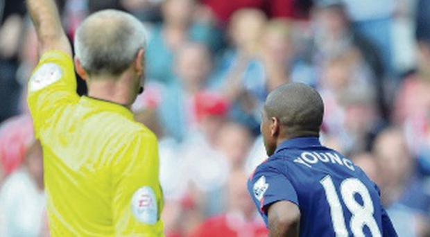 Defended: Ashley Young is shown yellow card for diving