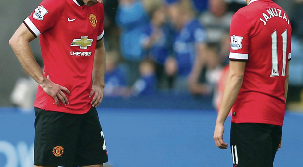 Seeing red: Robin van Persie and Adnan Januzaj are stunned by United's collapse