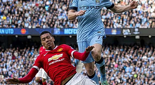 Seeing red: Chris Smalling brings down James Milner for his second yellow card