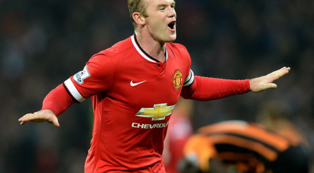 In the groove: Wayne Rooney celebrates hitting his goal against Hull at the weekend